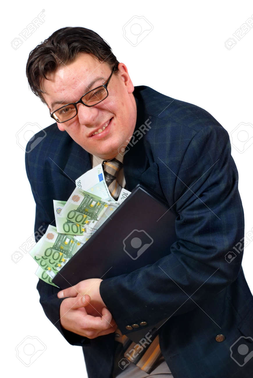 Greedy salesman holding on to his laptop PC stacked with euro bank notes with an apparent grimace of a lucrative but slick sale. - 951911