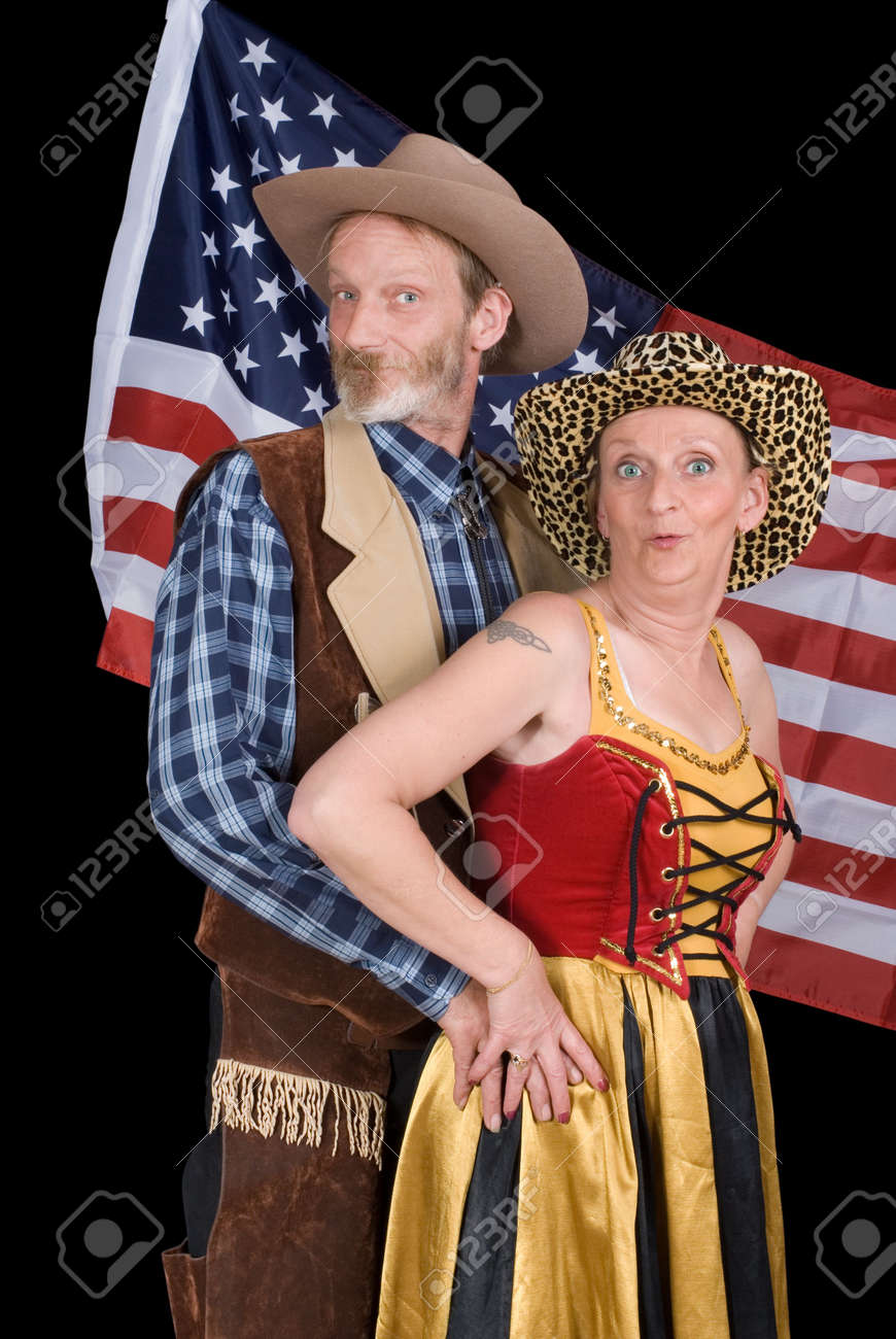 Senior married American couple in traditional cowboy Western outfit posing and backed by the stars and stripes flag. Stock Photo - 2733545