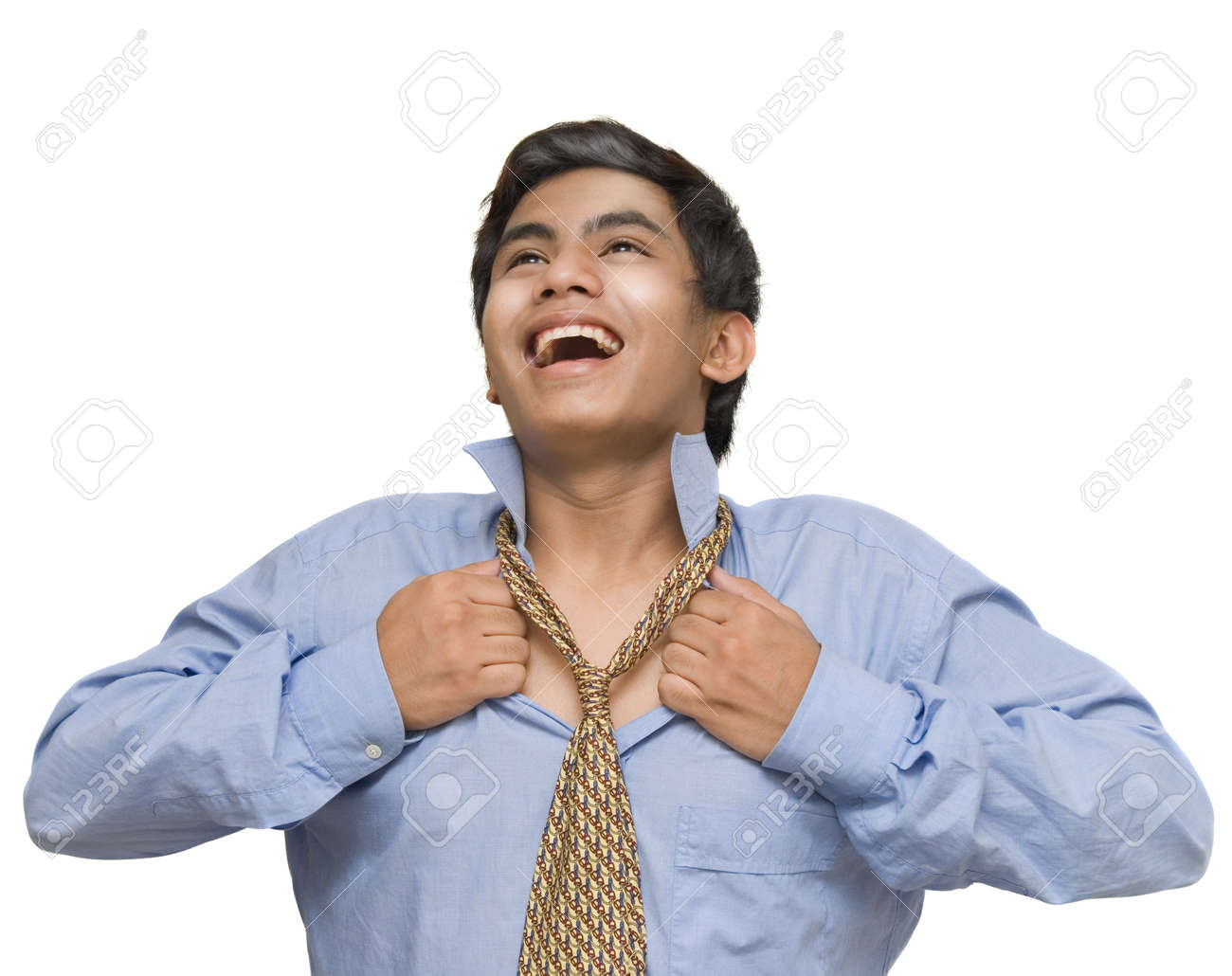 Young Indian or Asian corporate businessman cheering, smiling and opening his collar and necktie, breathing free and liberated. Isolated over white. - 5064361