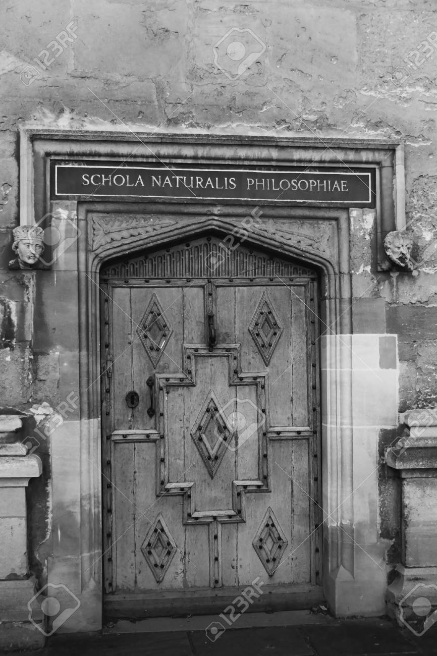 Black and white view decorative old door of schola naturalis philosophie natural philosophy school in university oxford