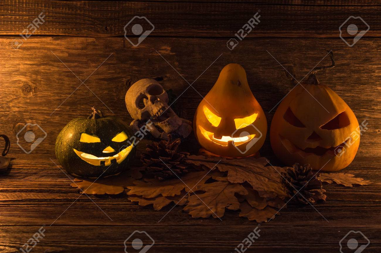 stock photo three glowing jack lantern on the eve of all saints day halloween card