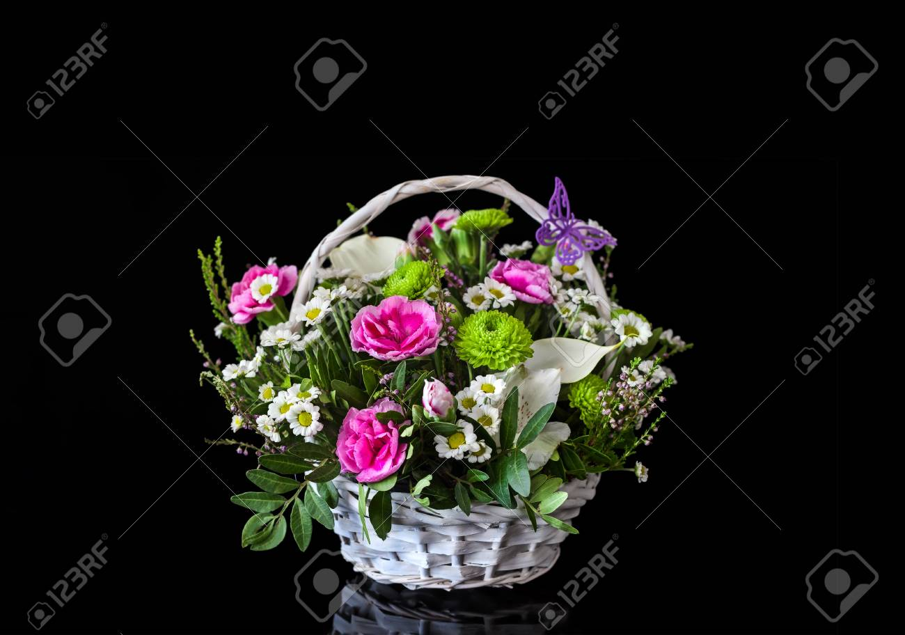 A bouquet of flowers in a basket natural flowers bright bouquet a bouquet of flowers in a basket natural flowers bright bouquet of black background izmirmasajfo