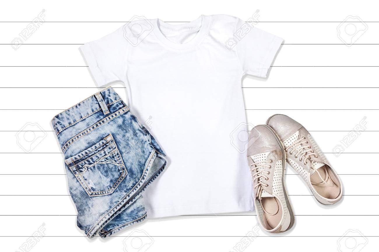 White Short Sleeve T Shirt Mockup On A White Wooden Background
