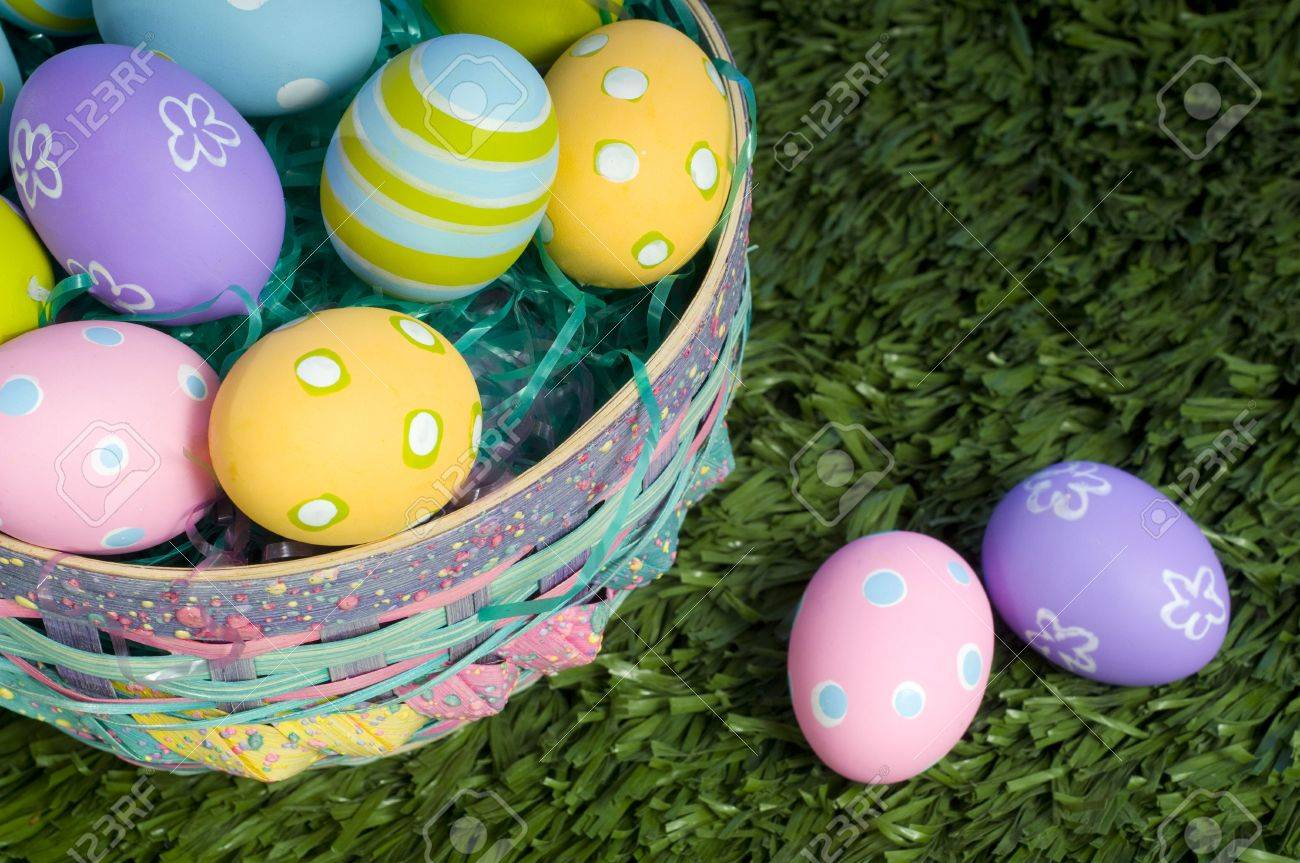 Brightly colored Easter eggs in a basket Stock Photo - 2668321