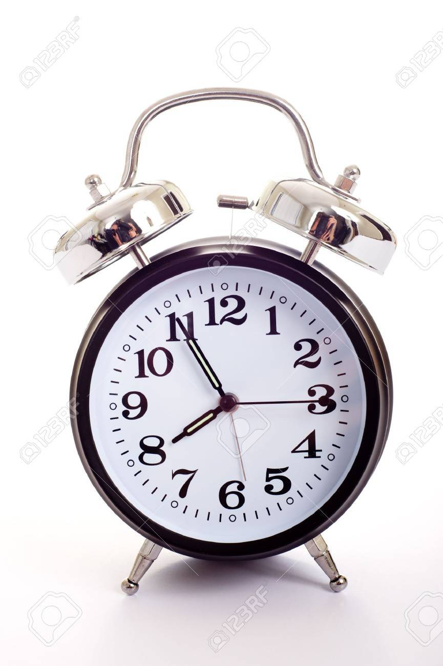 A Black Vintage Looking Alarm Clock On White Background Stock Photo