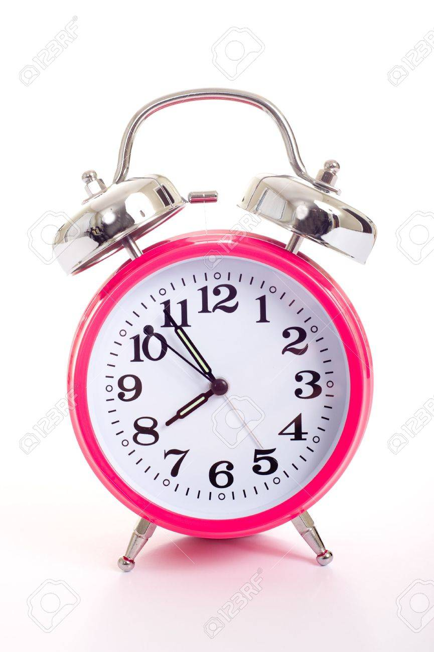 A Bright Pink Vintage Looking Alarm Clock On A White Background