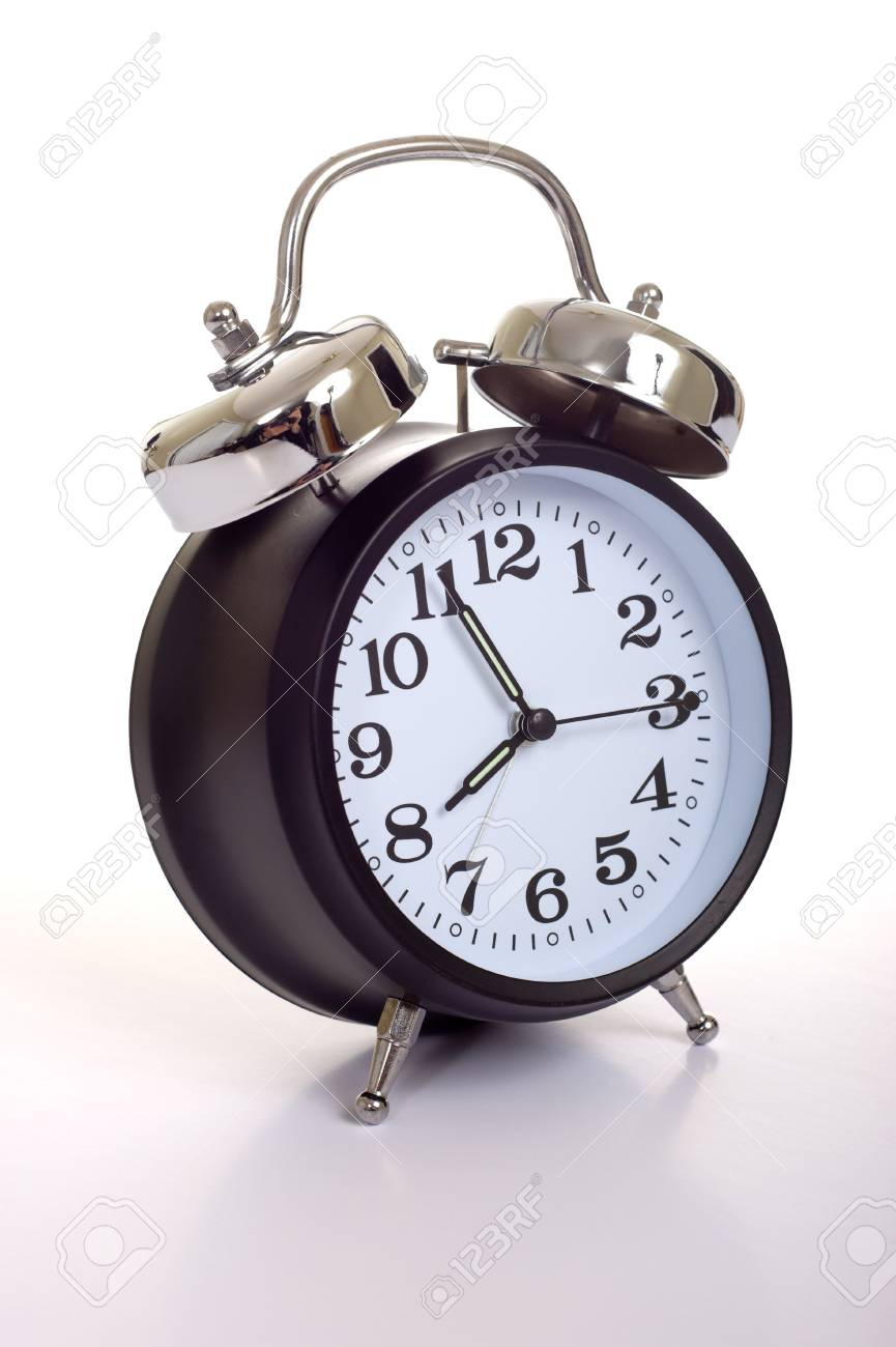A black, vintage looking alarm clock on white background Stock Photo - 3874812