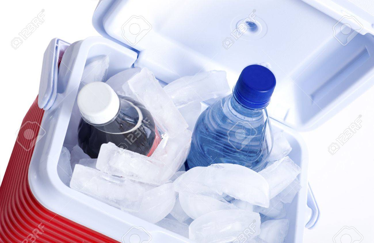 A small ice chest or cooler with drink including a cola and a bottle of water Stock Photo - 4722731
