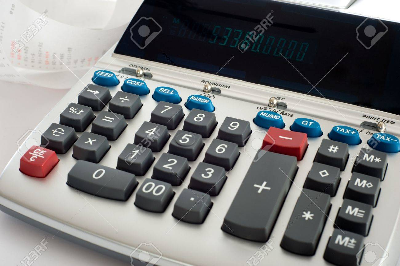 An adding machine or calculator with adding machine tape or paper