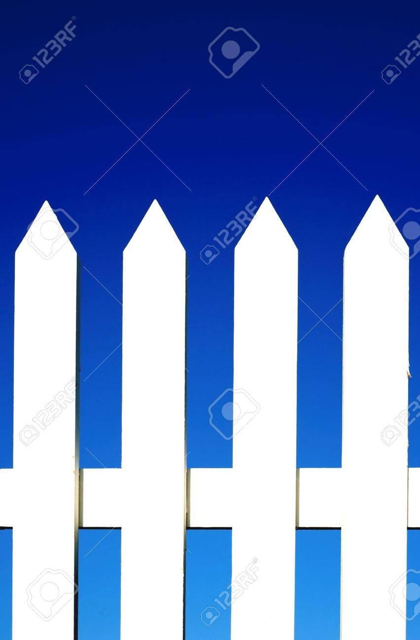 A white picket fence background in front of a bright blue sky with copy space. Stock Photo - 4725387