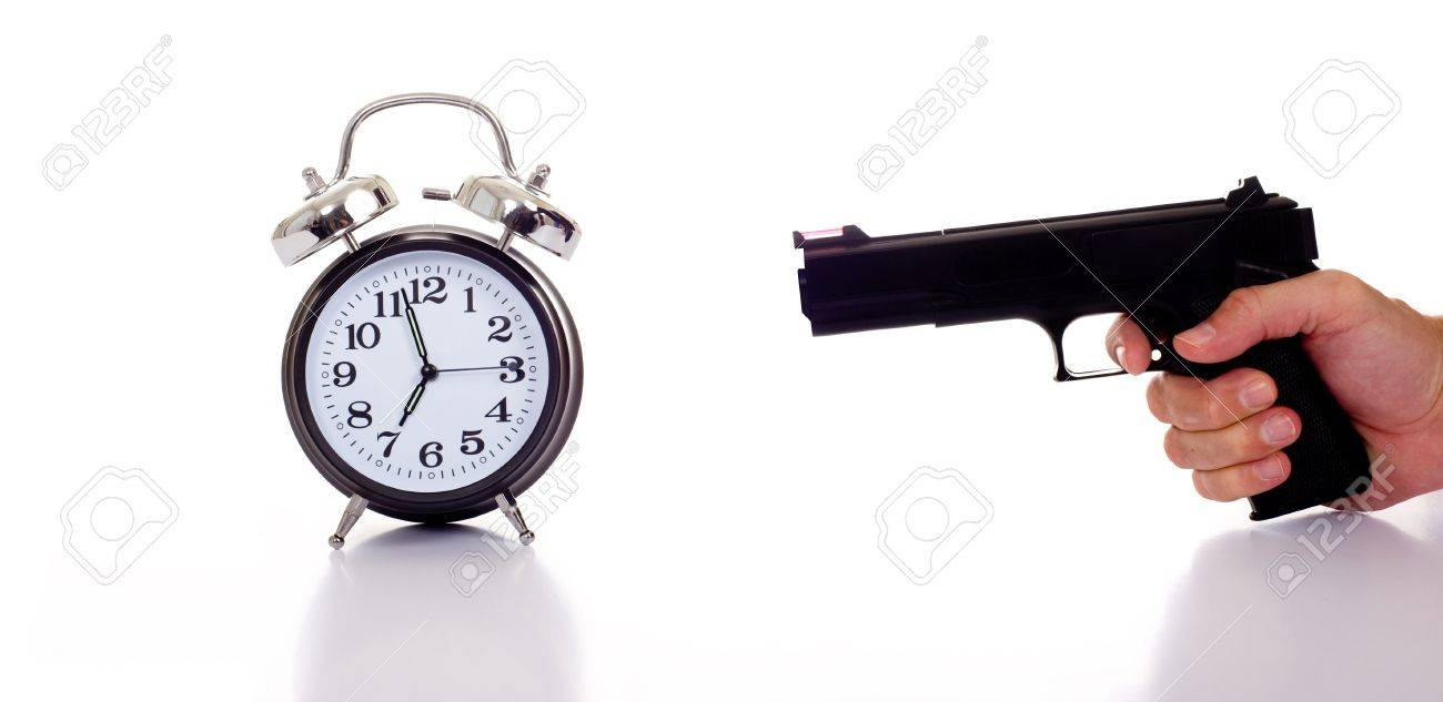 A Black Vintage Looking Alarm Clock With A Personor Man Holding