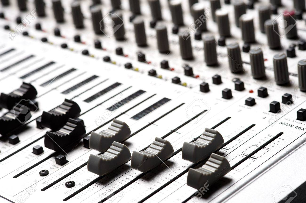 Audio recording equipment or soundboard background with many