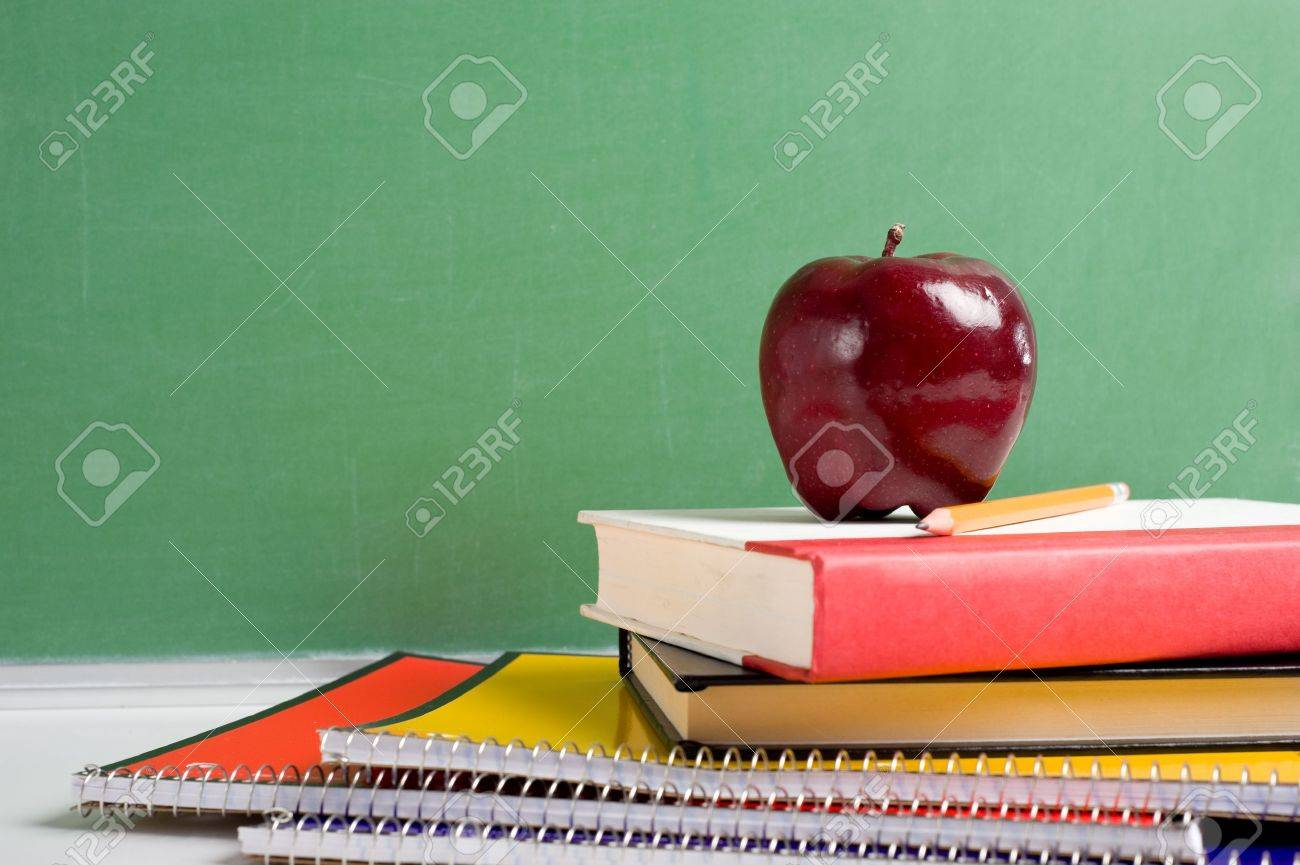 A Stack Of School Books And An Apple In Front Blank Chalkboard Or Blackboard