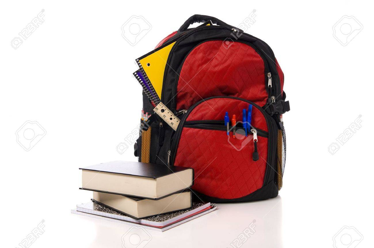 1523b507c80 A red overflowing school backpack or book bag with school books on a white  background Stock