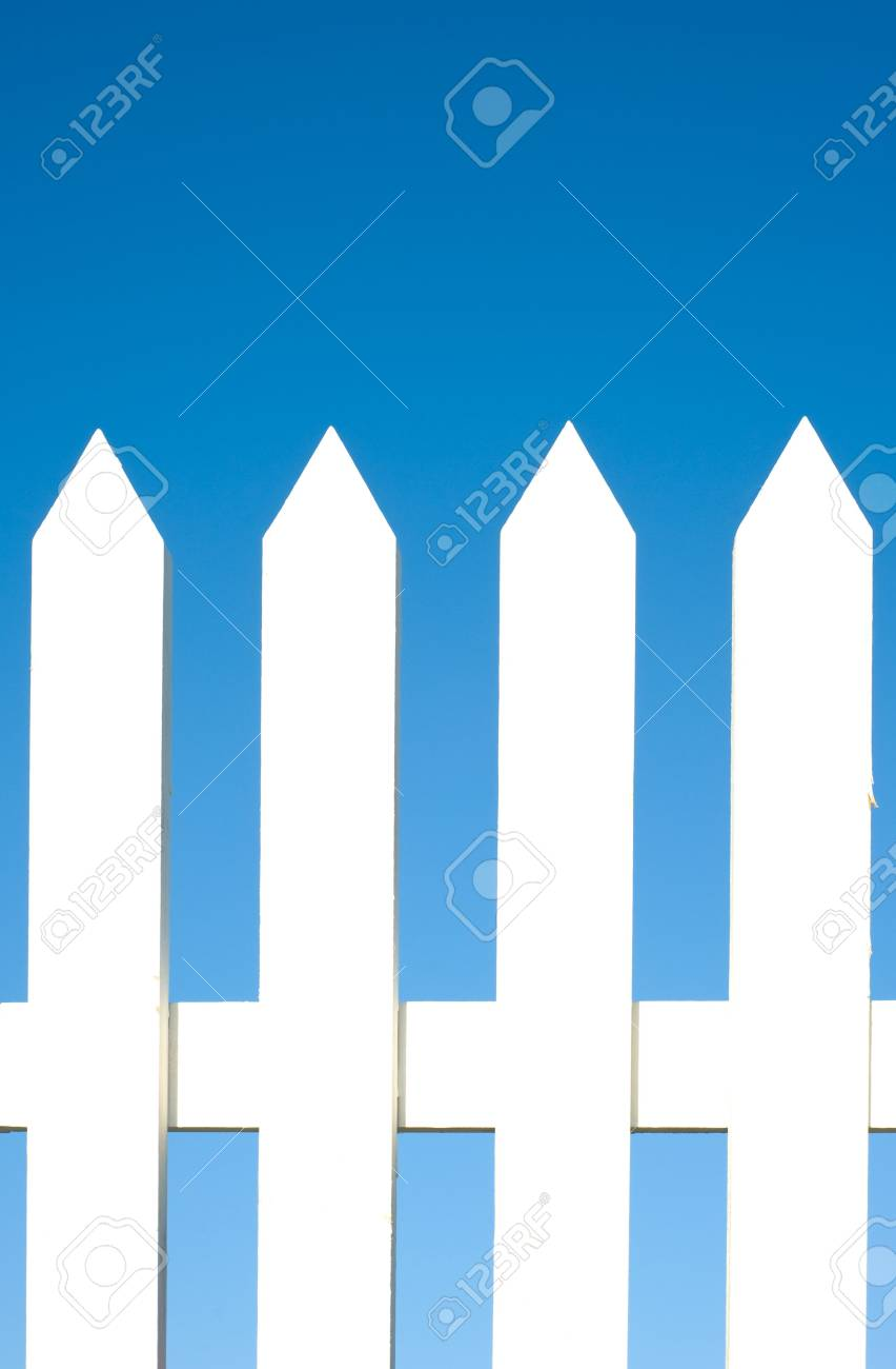 A white picket fence background in front of a bright blue sky with copy space. Stock Photo - 4725355