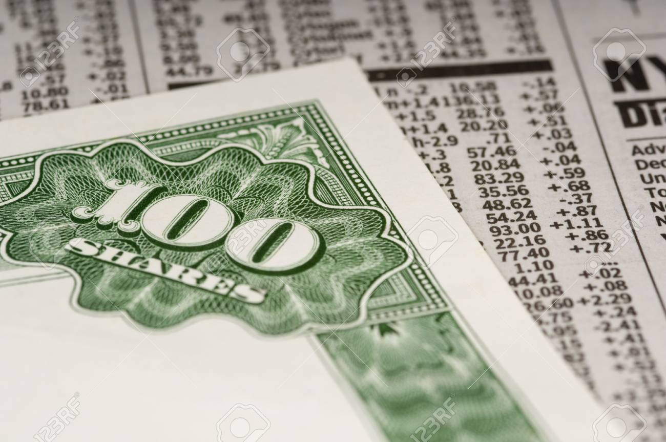 A stock certificate lying on top of the financial or business section of a newspaper Stock Photo - 4754099