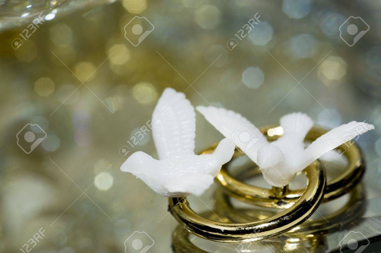 A Macro Of Love Bird Ring Decorations For A 50th Wedding