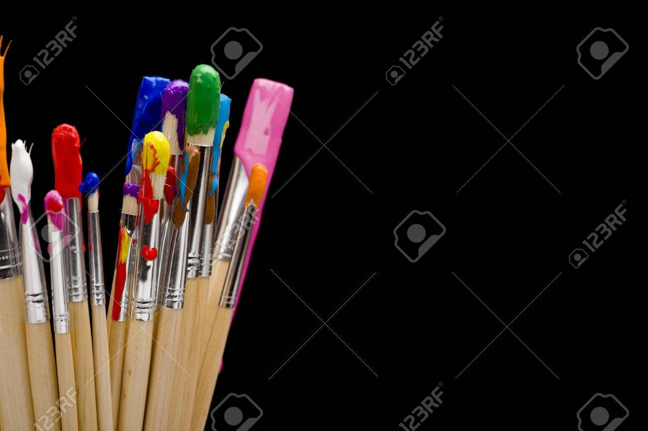 A group of multi-color painbrushes on a black background Stock Photo - 4753726