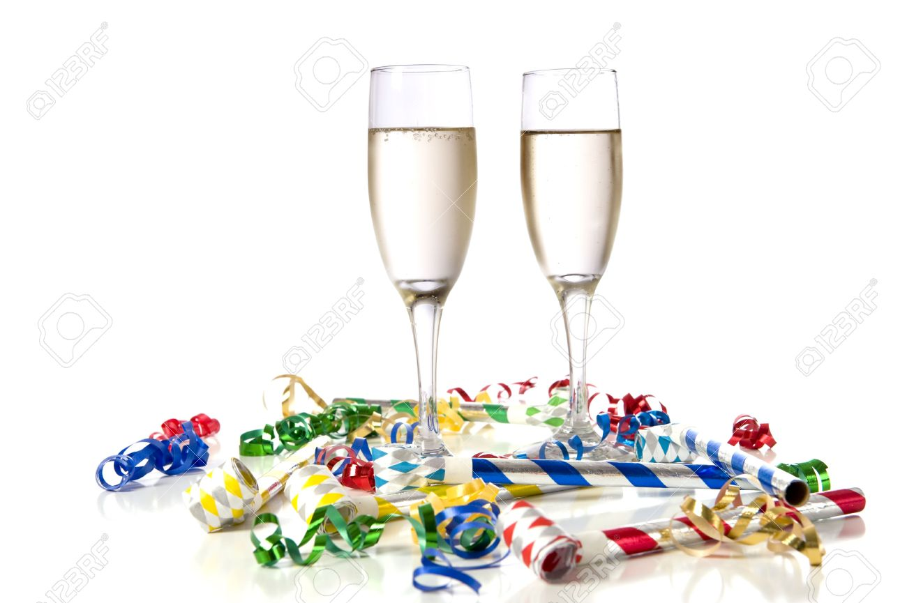 Two Glasses Of Champagne With Party Noise Maker And Streamers ...
