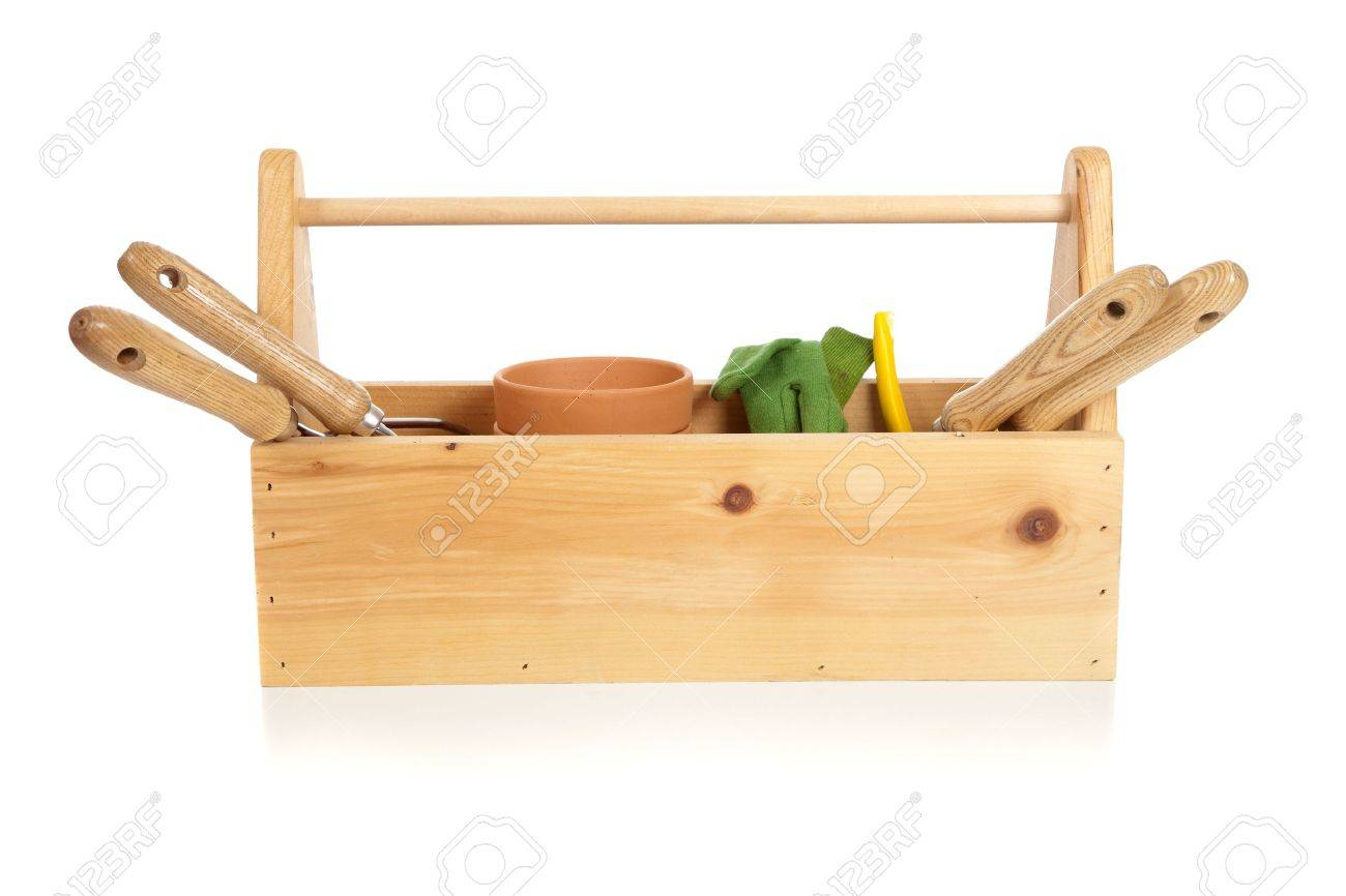A gardener's tote box on a white background with tools, plants and gloves Stock Photo - 5384854
