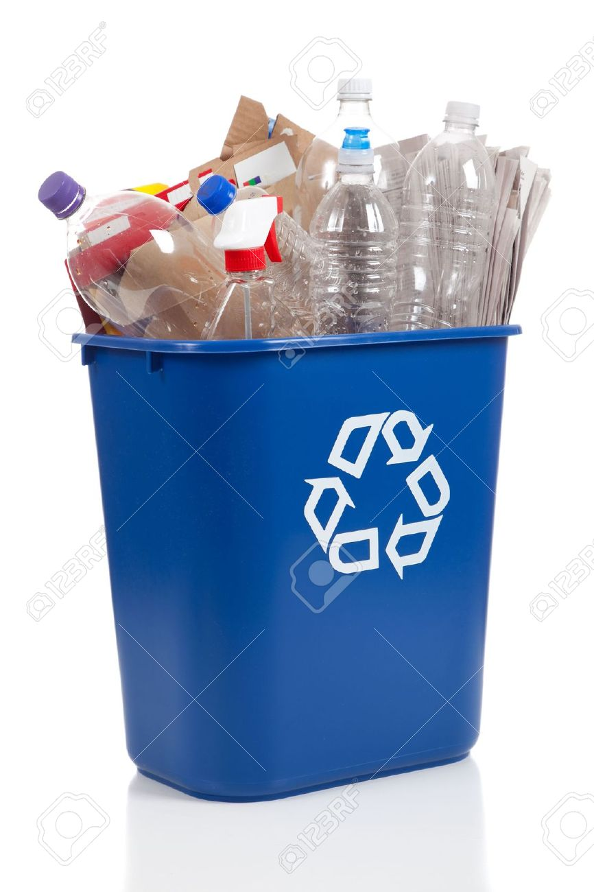 An overflowing blue recycle bin full of  plastic bottles, newspapers and boxes, with the recyle symbol on front Stock Photo - 5384861