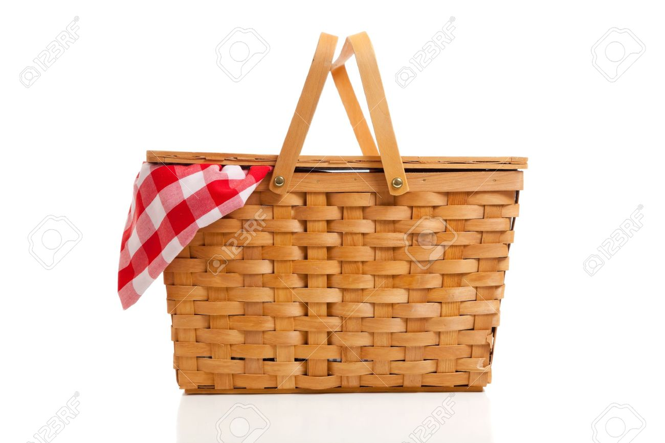 A brown wicker picnic basket on a white background with gingham cloth Stock Photo - 5452061