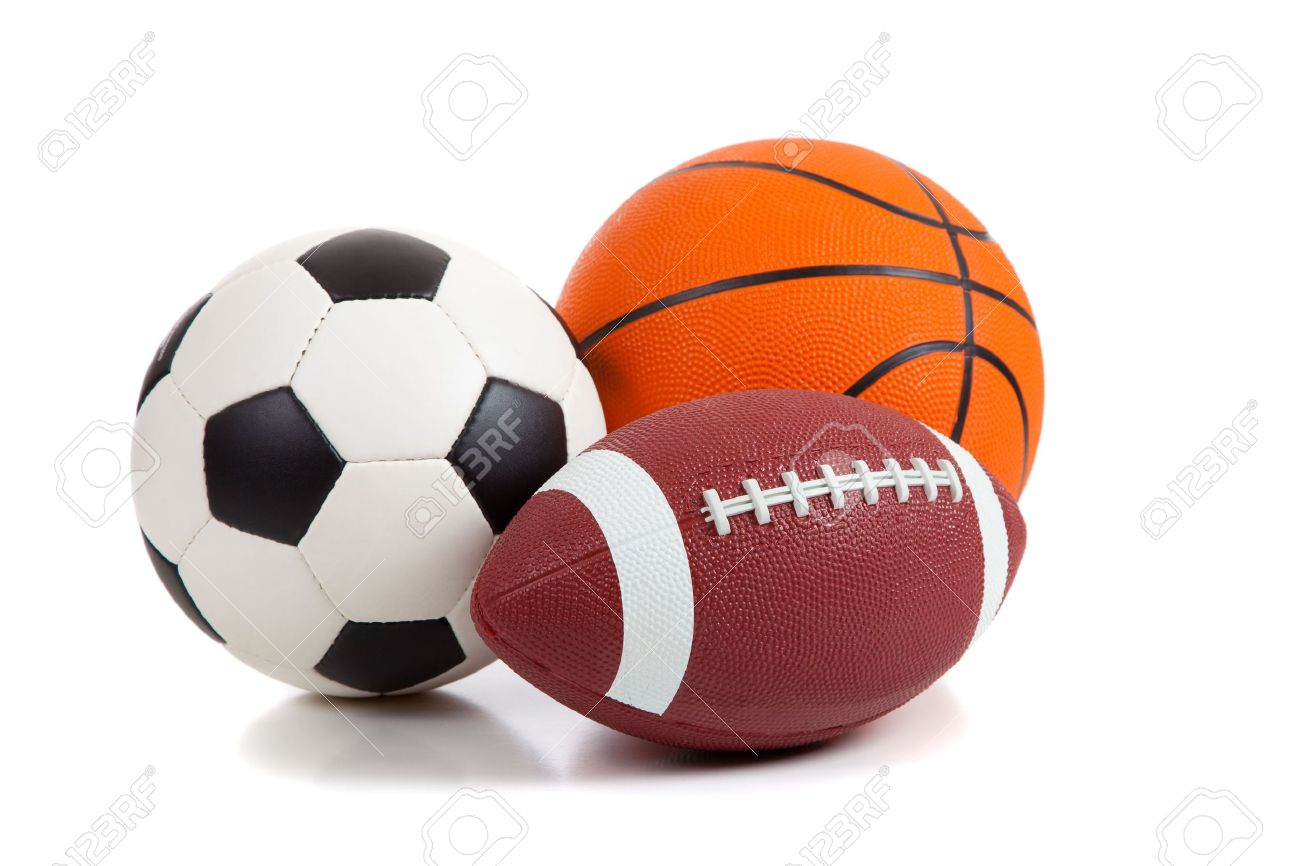 An American Football A Soccer Ball And A Basketball On A White