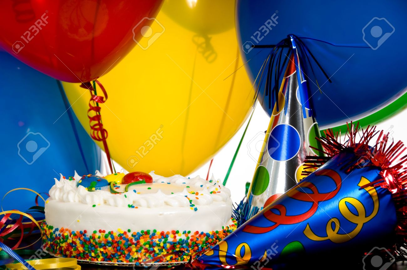 Birthday Cake Balloons Images ~ A birthday cake colorful balloons and party hats stock photo