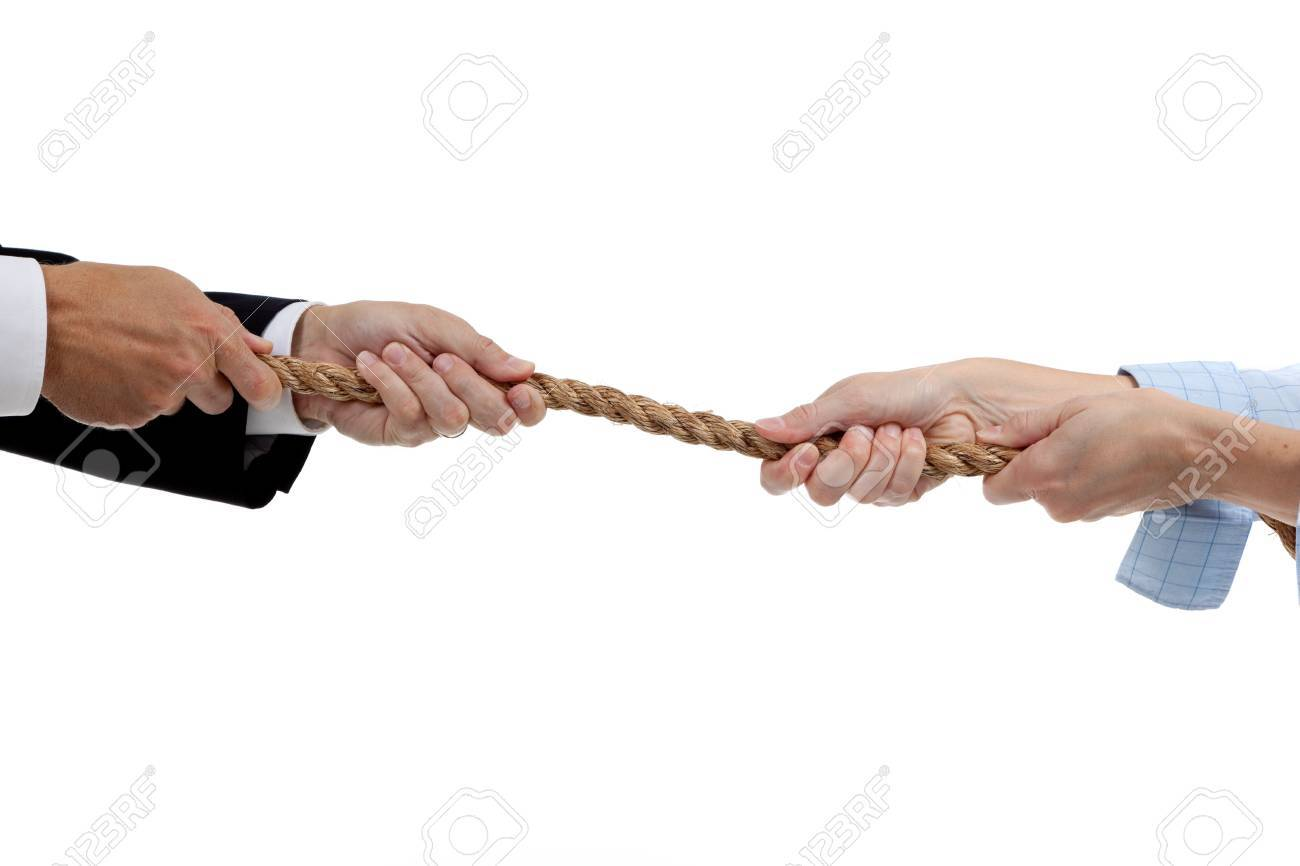 Man and a woman pulling a rope on a white background Stock Photo - 5658804