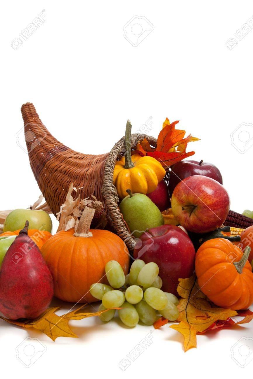 A Fall arrangement in a cornucopia on a white background Stock Photo - 5709993
