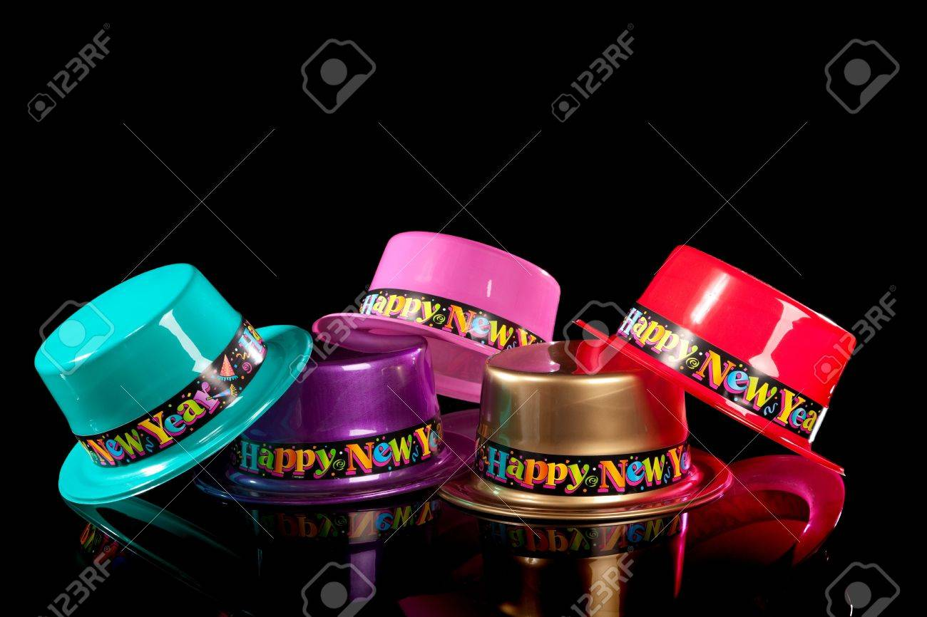 Colored New Years Eve hats including green, purple, pink gold and red on a black background Stock Photo - 5971000