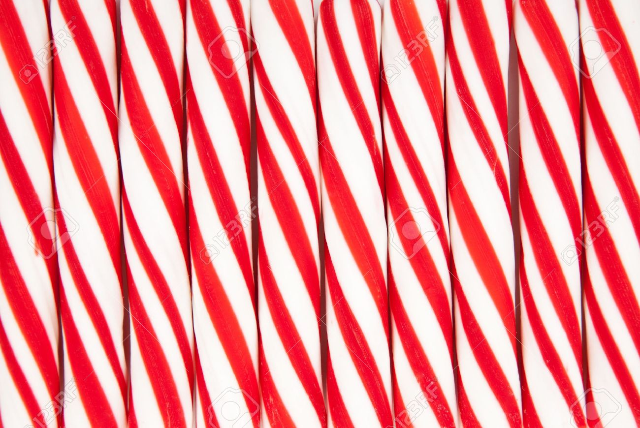A Background Made Of Red And White Striped Candy Canes Stock Photo ...