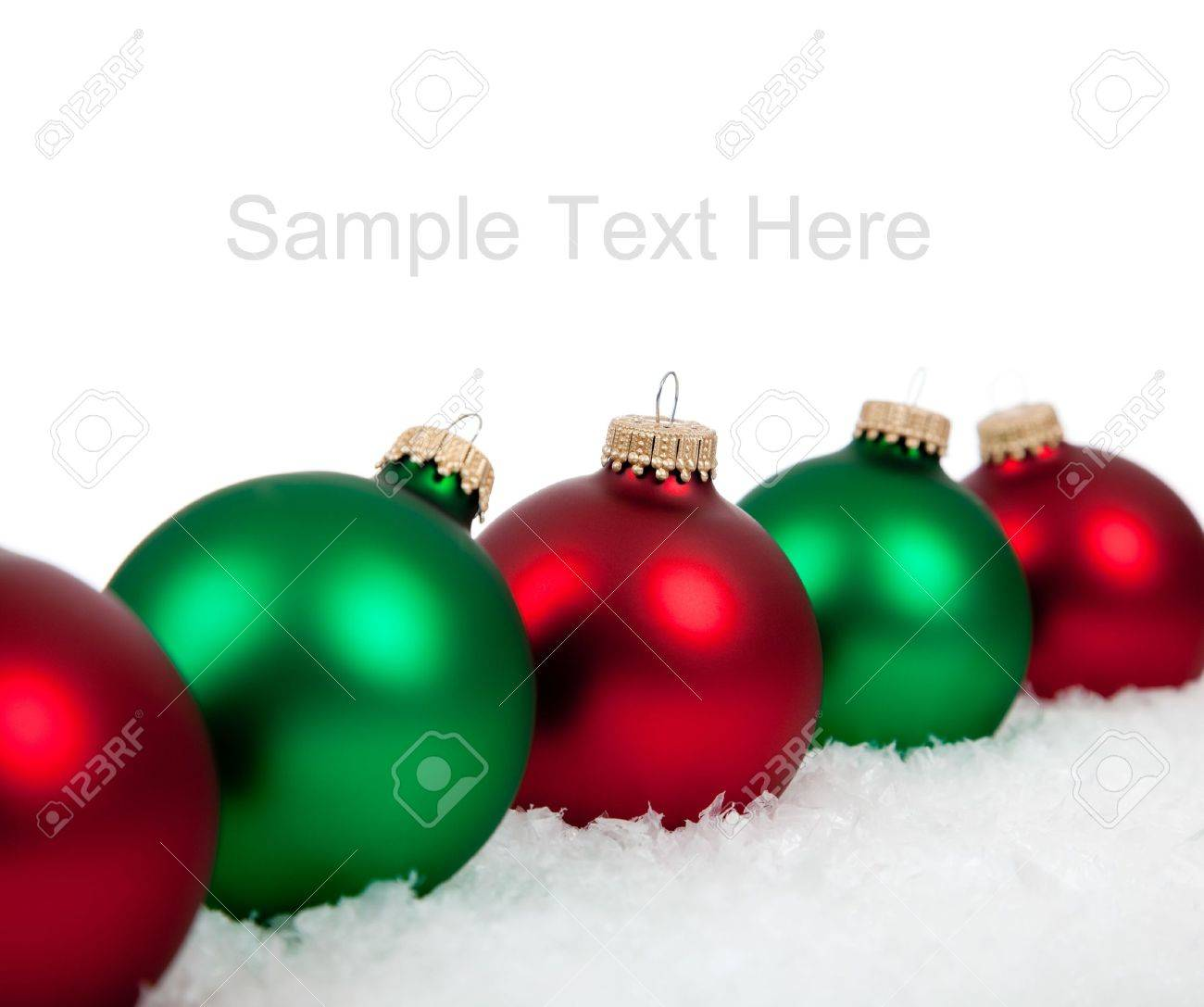 Red green and white christmas ornaments - Green And Red Christmas Ornaments Baubles On A White Background With Copy Space Stock Photo
