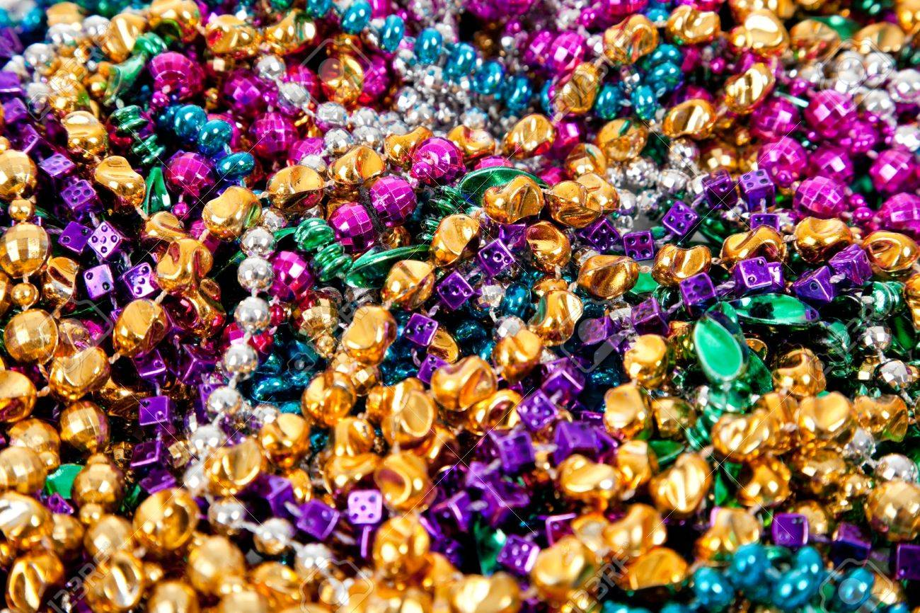 Background made up of mulit-colored including gold, purple, blue, green and pink mardi gras beads Stock Photo - 6070069