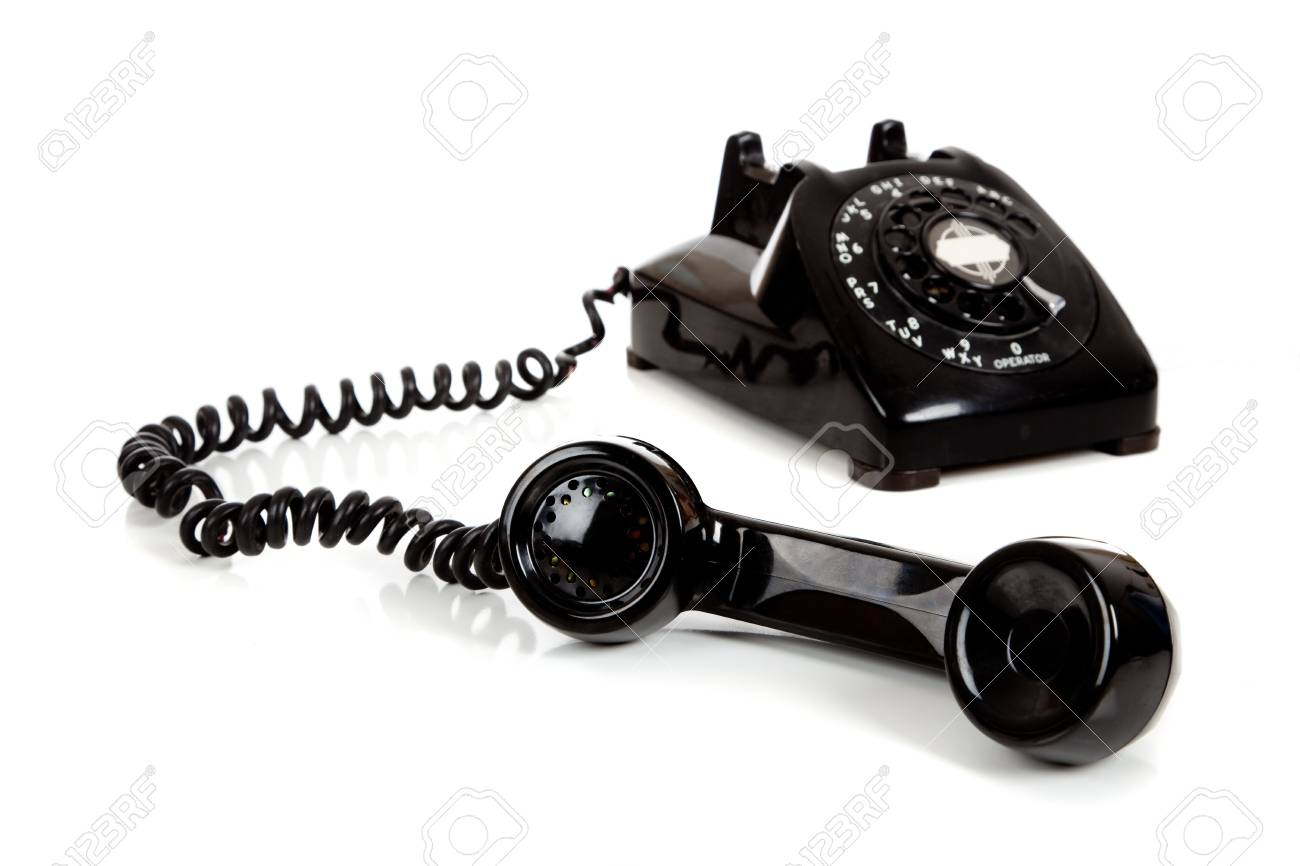 A vintage black telephone  with a white background Stock Photo - 6756433