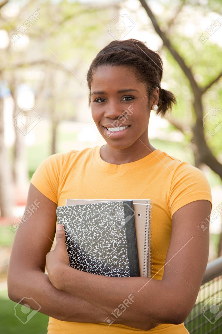 African American Female College Student outdoors with books Stock Photo - 9601915