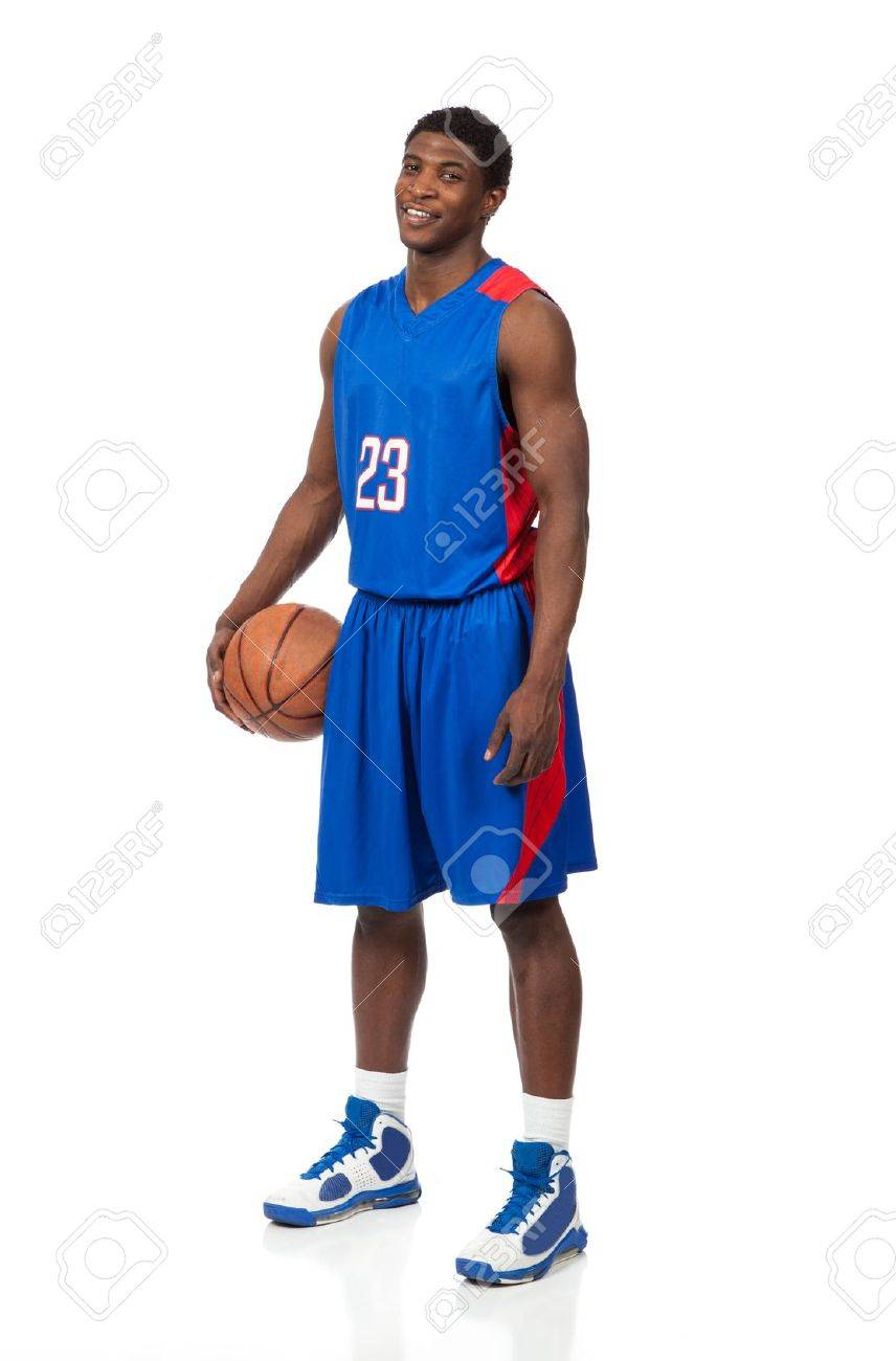 A young african American basketball player in a blue uniform on a white background - 17277796