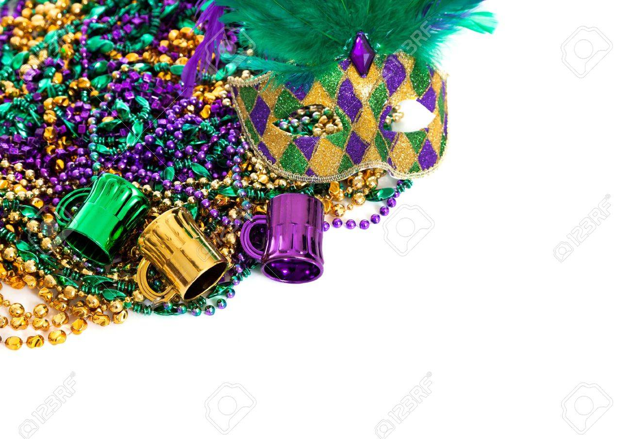 Assorted colored Mardi gras beads on a white background with copy space - 17288213