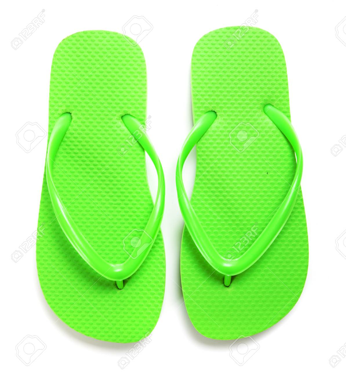 A Pair Of Lime Green Flipflops On A