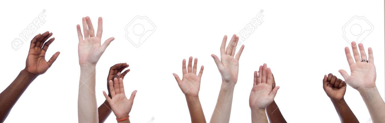 A group of multi-cultural hands raised upward - 23904572