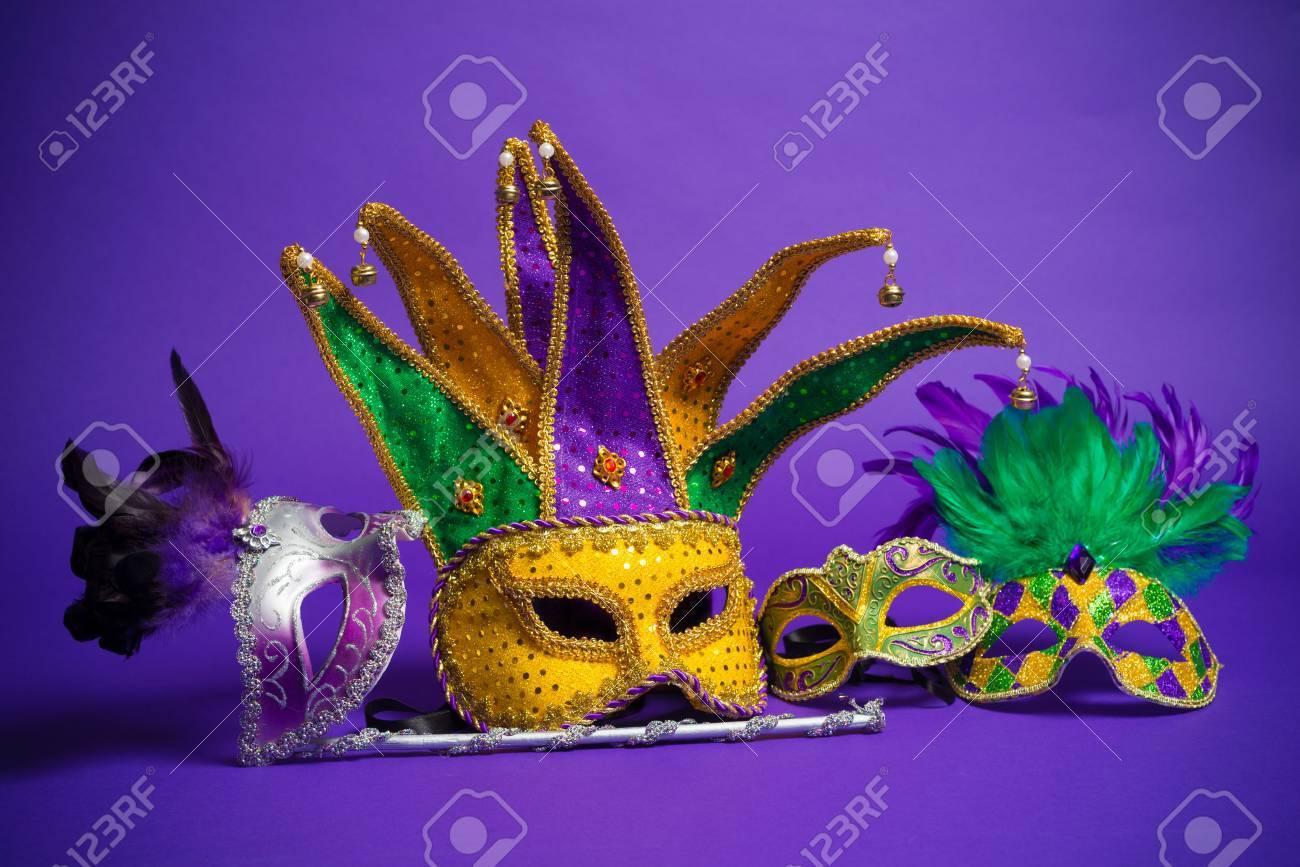 Festive Grouping of mardi gras, venetian or carnivale mask on a purple background - 25892119