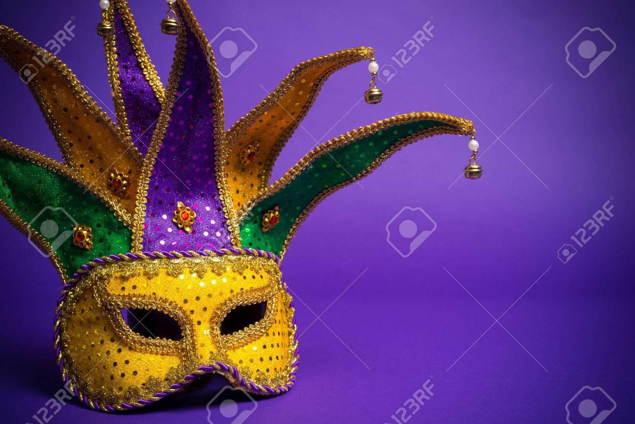 Festive mardi gras, venetian or carnivale mask on a purple background - 25892118
