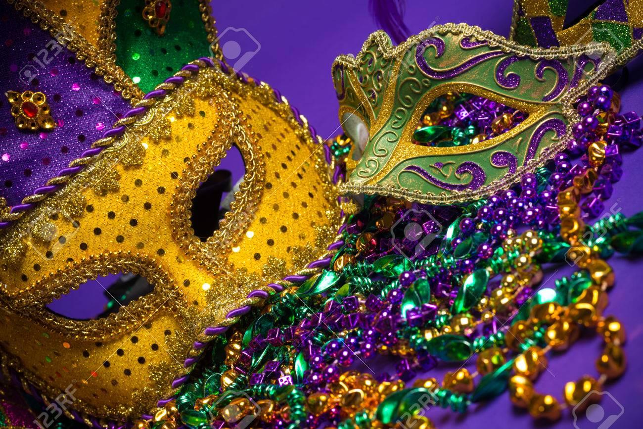 Festive Grouping of mardi gras, venetian or carnivale mask on a purple background - 25892125