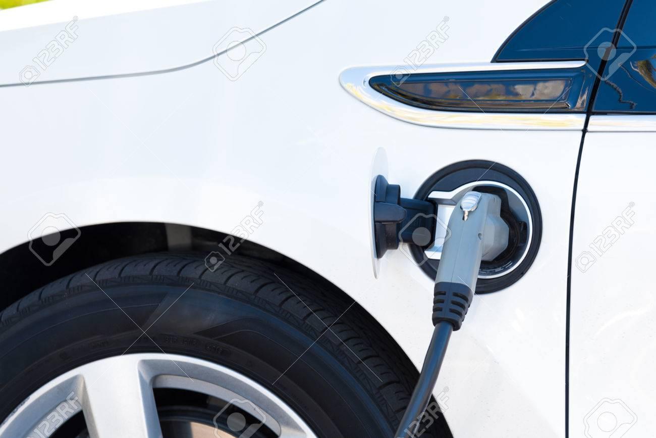 An electric car charging in California - 44662647