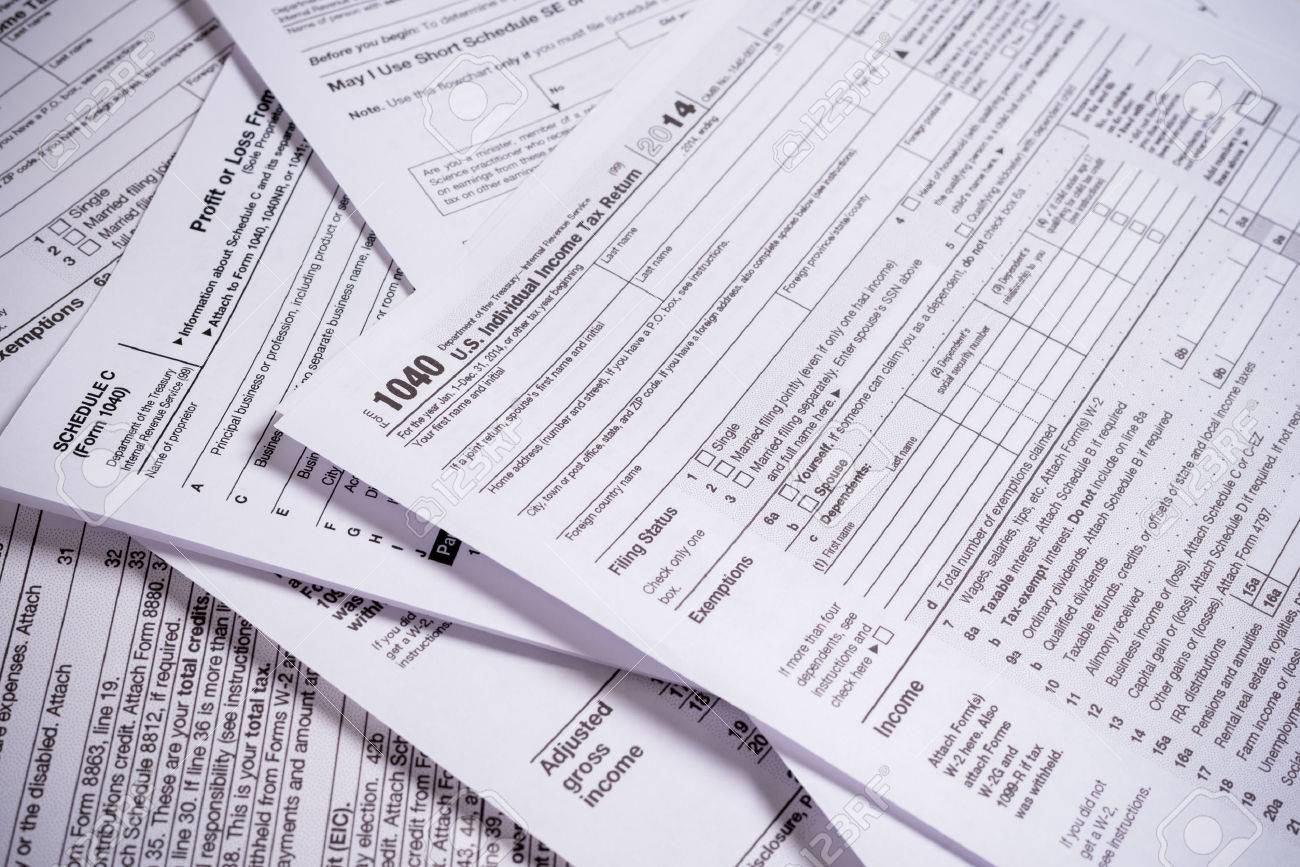 A variety of United States tax forms with a pencil - 44670287