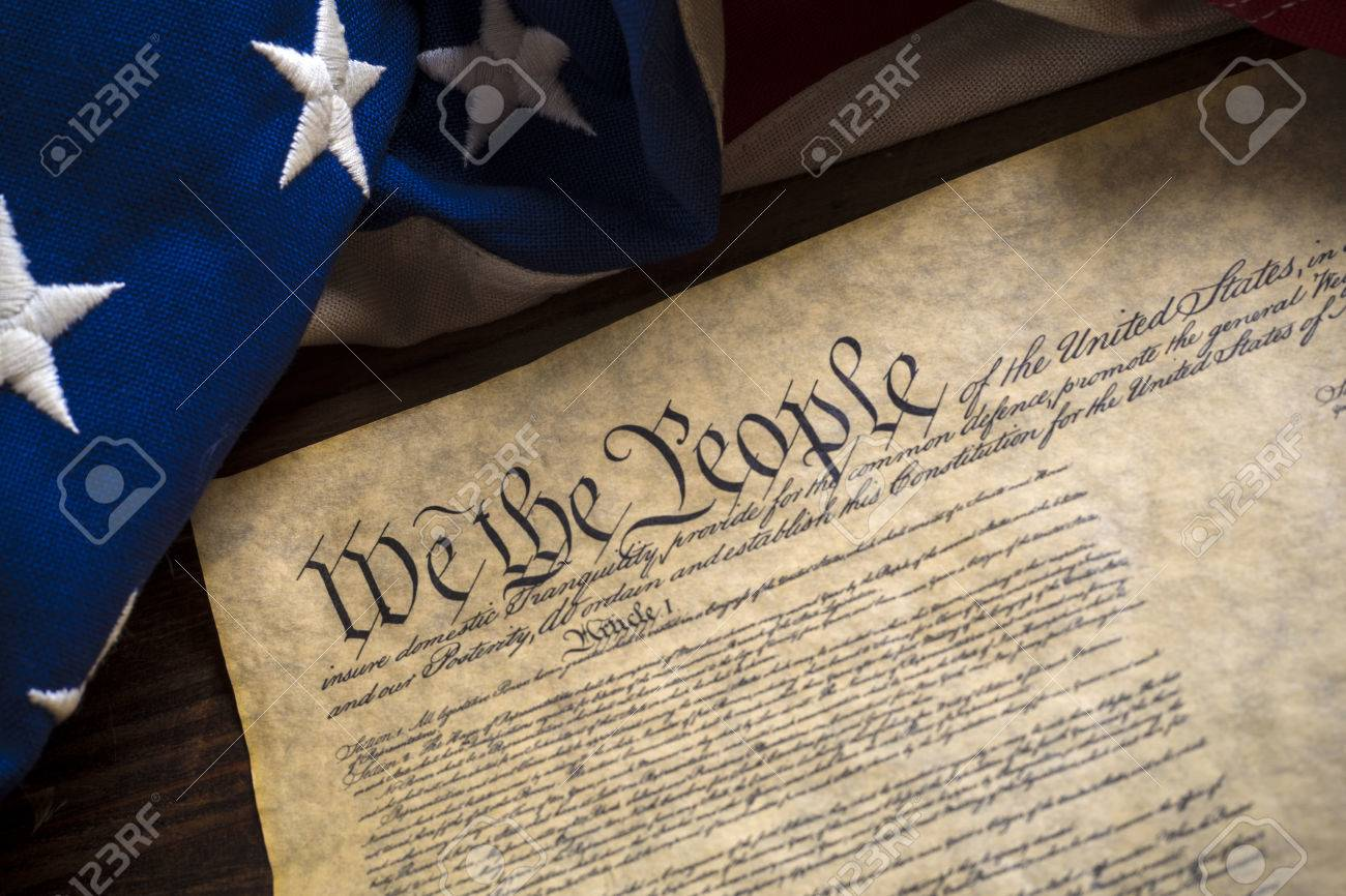 The constitution of the United States of American with a vintage flag - 44577573
