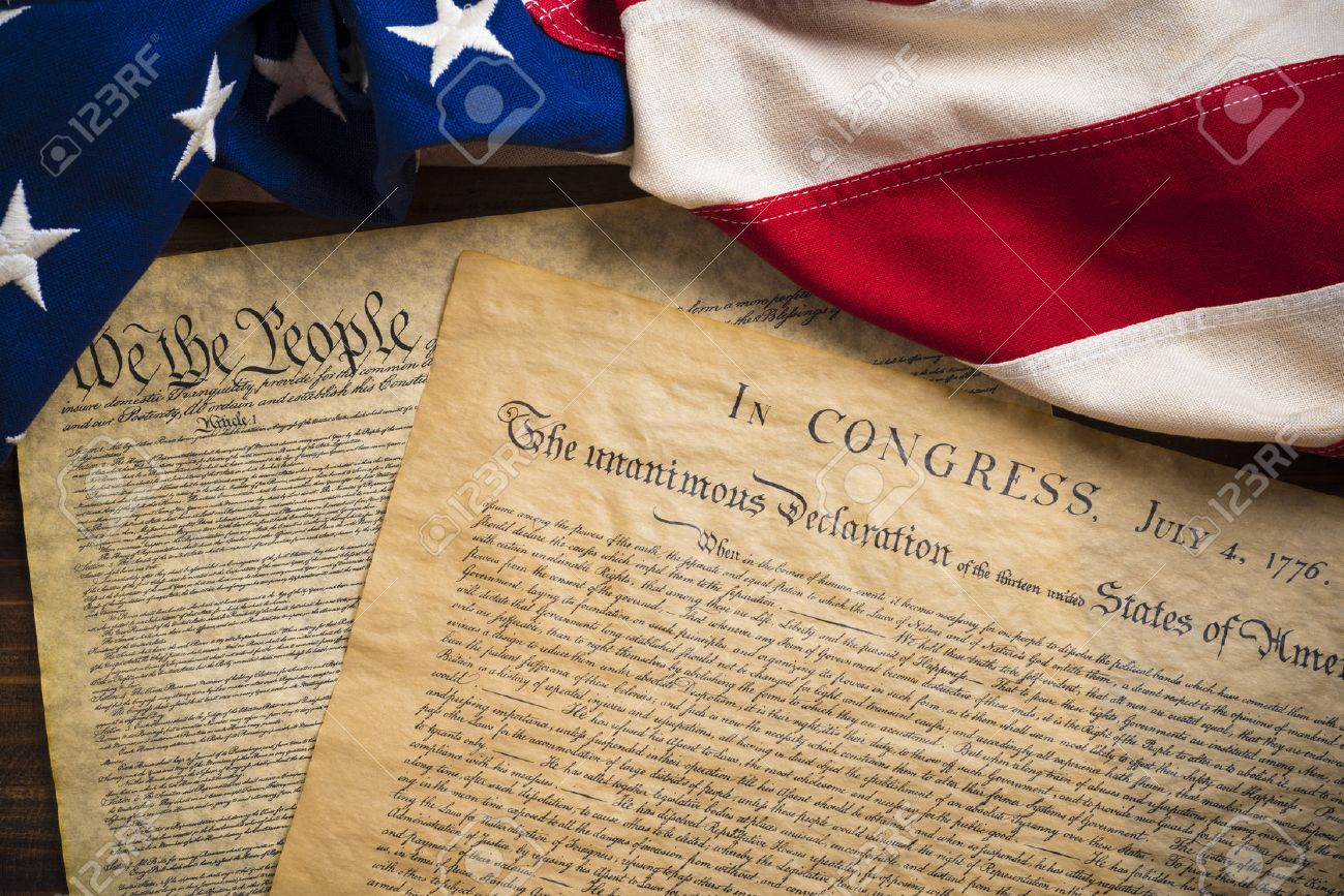 The Declaration of Independence and Constitution of the United States of America with a vintage flag - 44868478
