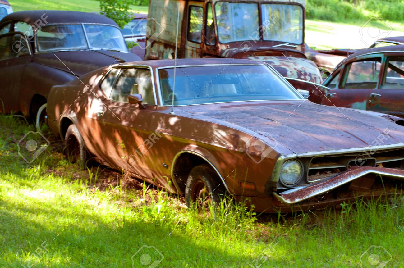 Rusty Old Cars In Abandoned Place, Junkyard - Vintage Style Stock ...