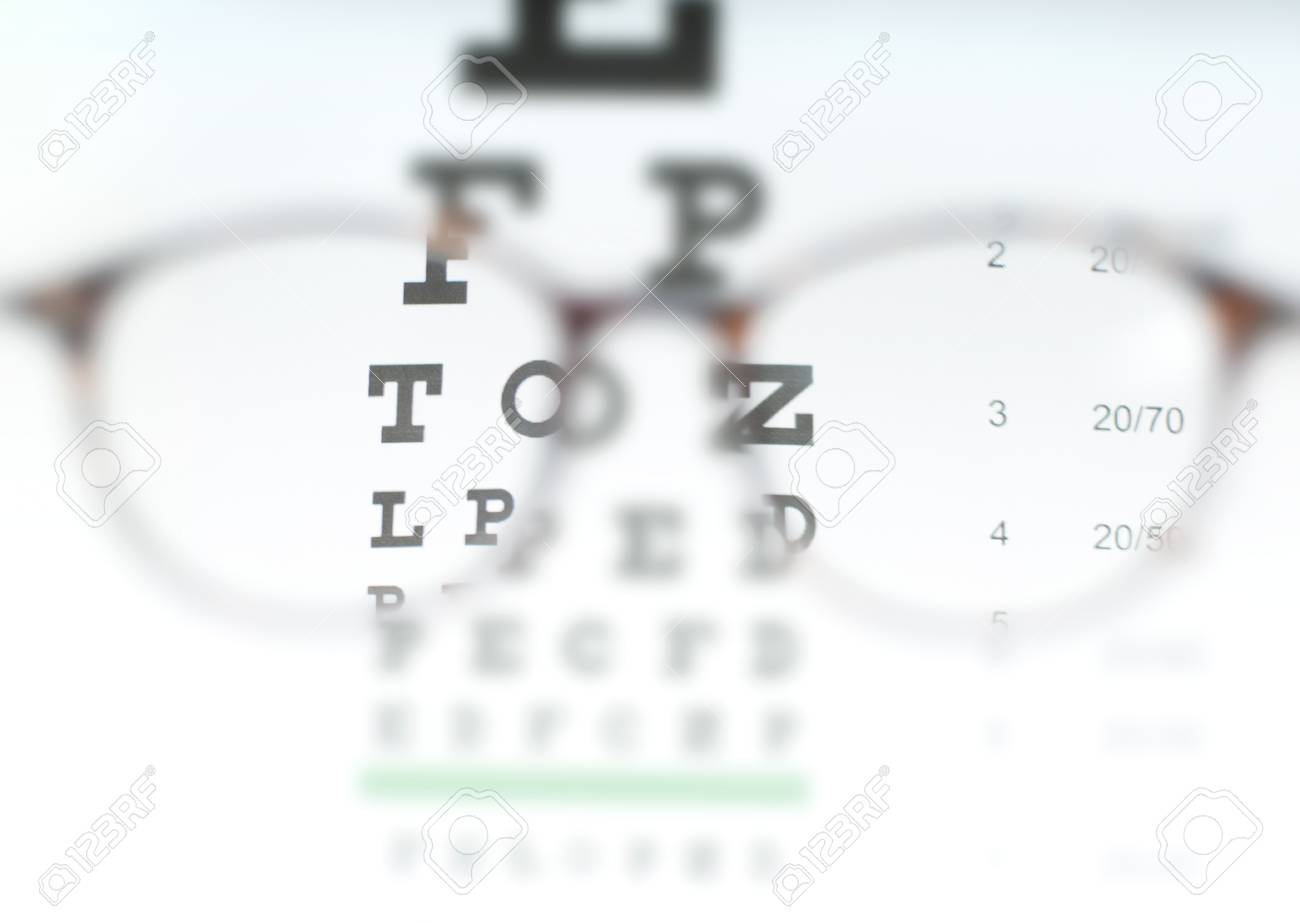 Eye vision test chart seen through eye glasses prescription stock eye vision test chart seen through eye glasses prescription glasses sitting on an eye test geenschuldenfo Image collections