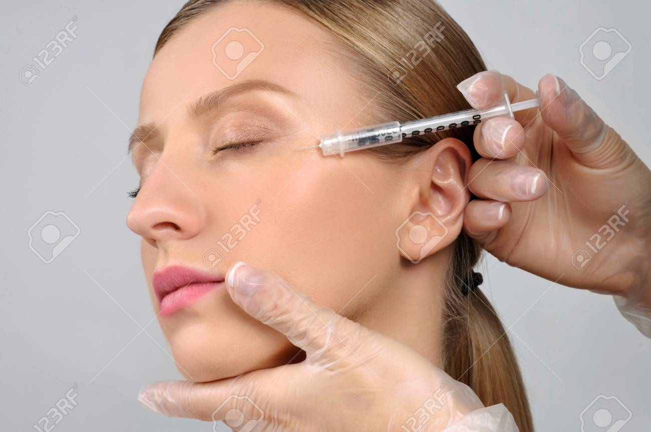 Woman Is Getting Injection Anti Aging Treatment And Face Lift